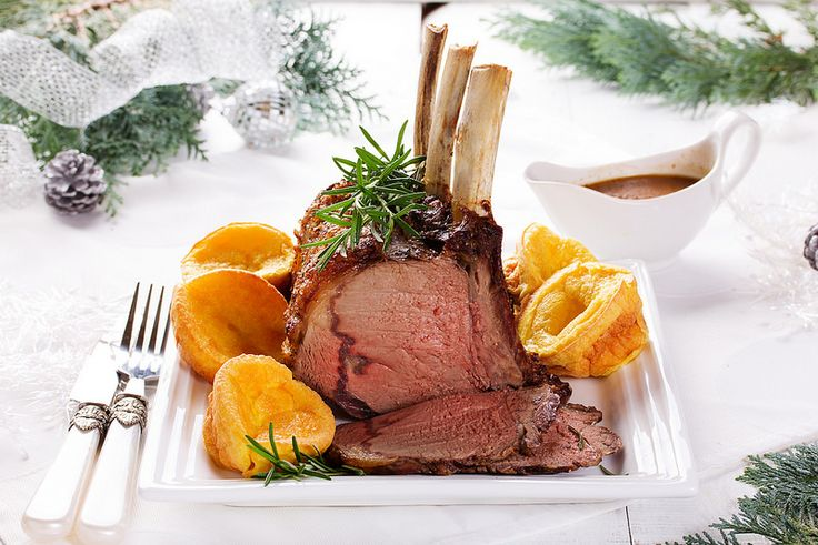 Christmas roast beef with Yorkshire pudding. Festive dinner.