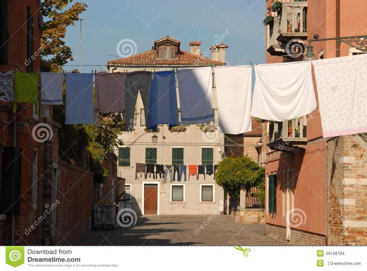 Venice with the sun. Photo of a small field (equivalent to the square) sittuato in the residential area, away from purely tourist paths. stand out in the picture, in the foreground, the pannie colored, freshly laundered, hung out to dry.