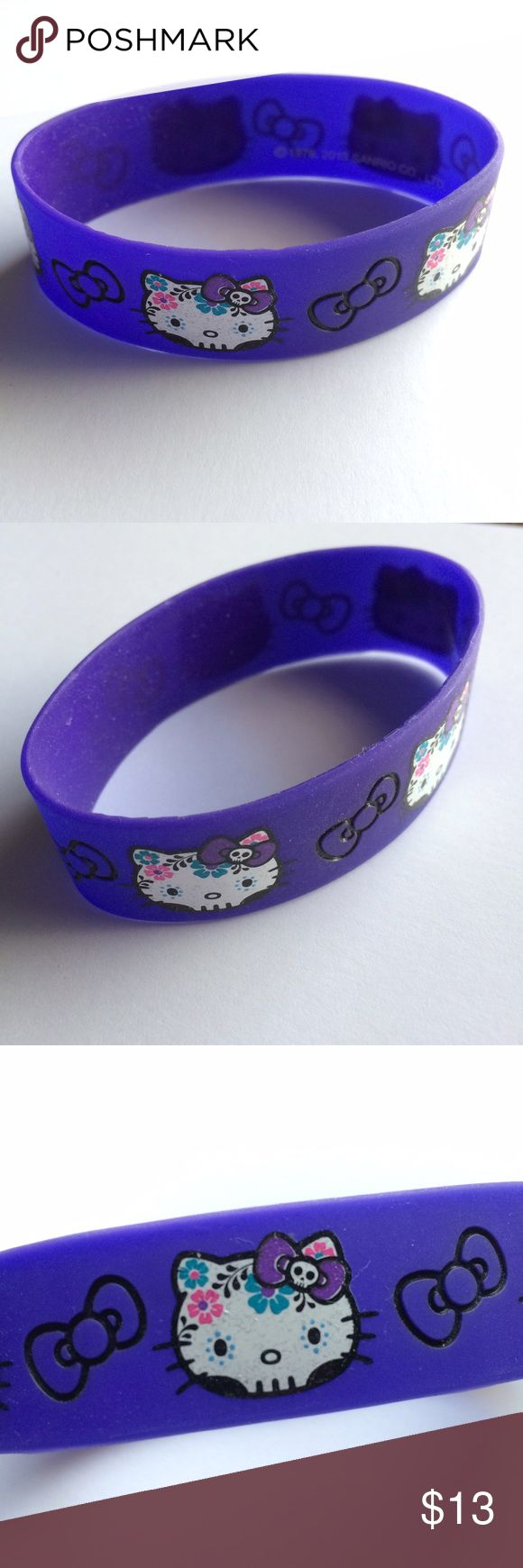 Hello Kitty Dia DeLos Muertos Sugar Skull Bracelet Add some sweetness with this dia de los muertos & sugar skull-inspired Hello Kitty rubber/silicon bracelet! Loved for a while, then wasn't my style; used to work for Sanrio. Barely worn, excellent condition without peeling or discoloration. Bundle it up with other Hello Kitty items or something else in my closet and get 15% off 2+ items! Hot Topic Jewelry Bracelets