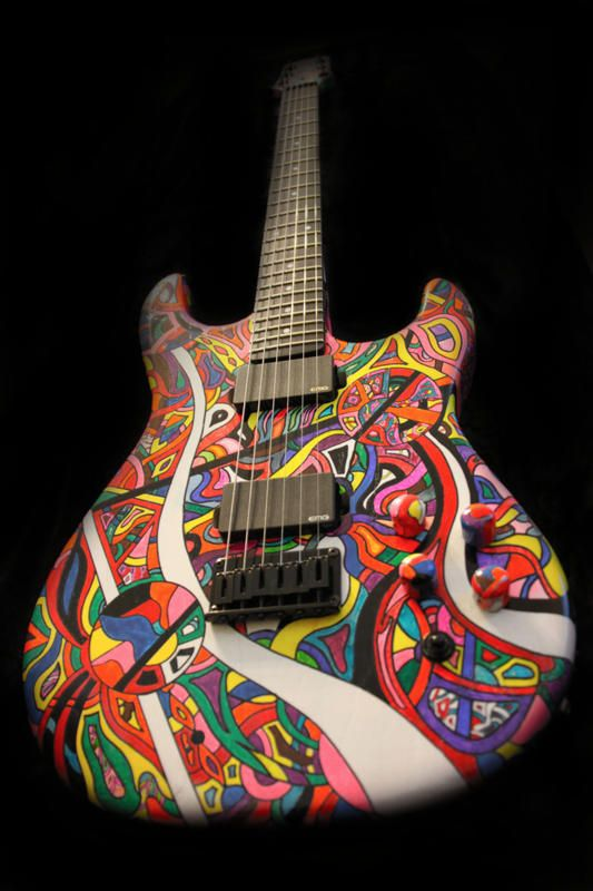 The Yakima is built and decorated by hand with original artwork by K. Daniel Menard - this is the only one of its kind.  Here's a list of the hardware: EMG Zakk Wylde active pick ups - 81 + 85 Black Sperzel Locking Tuners Black DunLop Strap Lock System Black Jackplate and Neckplate Wood: Body - Swamp Ash,slightly rounded, w/ enhanced cutaway Neck - Maple W/ Ebony fingerboard Tradition Headstock Black Hardshell case Memphis Nickle WebStrings - XLPlus