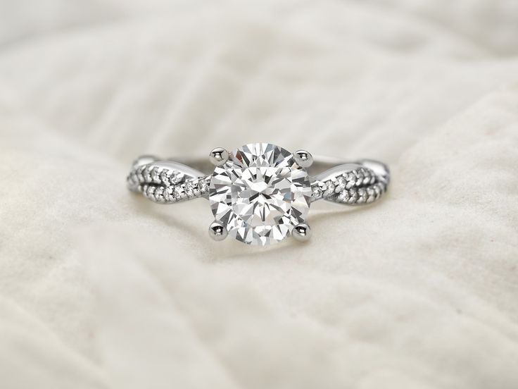 strand of diamonds entwined with a high polished ribbon of precious metal.