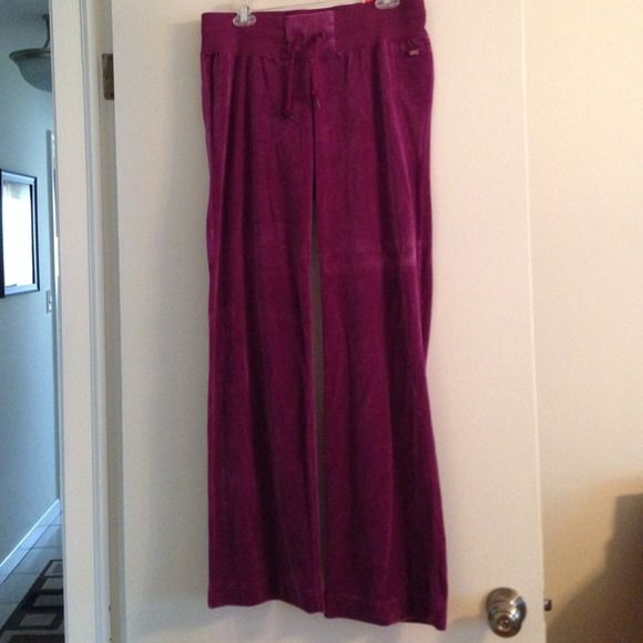 NWT Nike Modern fit athletic pants NWT purple Nike Modern Fit Athletic pant with about a 32 1/2 inch inseam. 78% cotton 24% polyester. Nike Pants