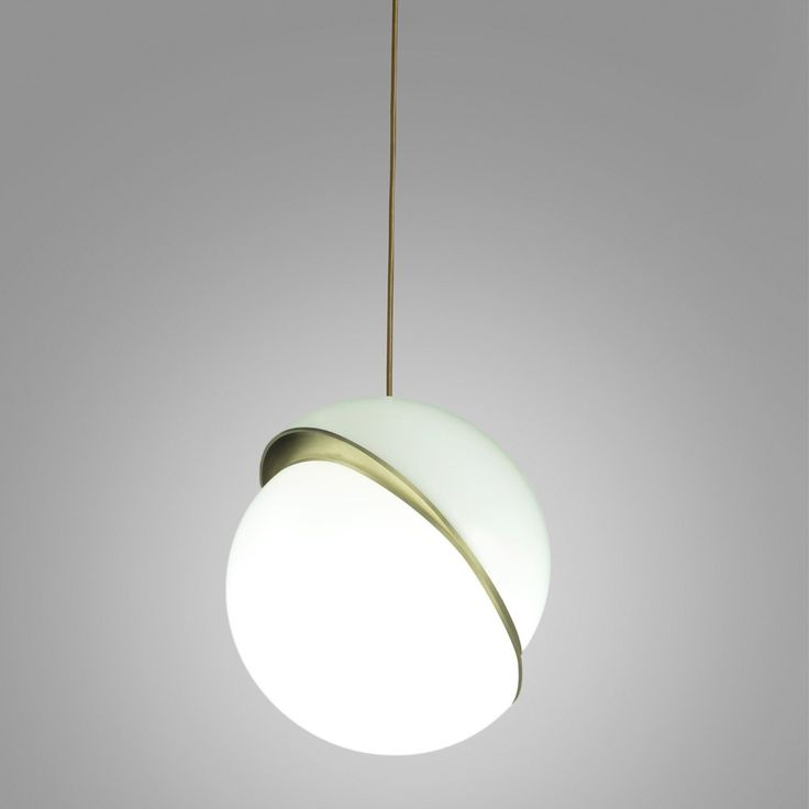 Lee Broom Crescent Light - Opaque spherical pendant light with crescent-shaped brushed brass fascia. Embrace the restrained opulence of the Lee Broom Crescent Pendant Light. Taking style cues from classic globe light fittings, this luxury pendant light has been reinterpreted, adding a touch of glamour to contemporary environments. Starting as an opaque acrylic globe, the spherical shade is sensationally spliced in half to reveal a crescent-shaped facade. Glistening brushed brass then ado...