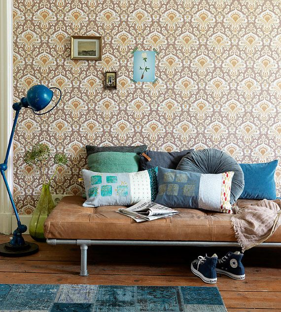 diy couch bed lounge! you could do this with pipes a foam seat and do a tufted diy!