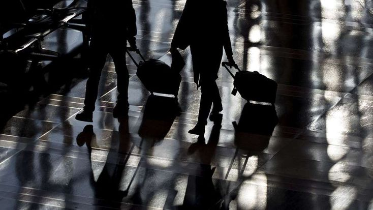 New York, Boston Bear Brunt of Canceled Flights Ahead of Storm  - January 3, 2018.  Travelers walk through Ronald Reagan National Airport (DCA) in Washington, D.C., U.S., on Wednesday, Nov. 22, 2017. The trade association Airlines for America has projected that 28.5 million passengers will travel on U.S. airlines during the 12-day Thanksgiving air-travel period, up 3 percent from 2016.
