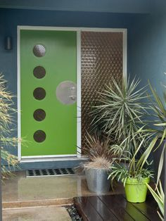 Awesome midcentury look with cool colors and plants