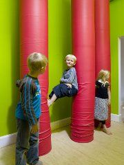Ordrup school in Denmark - spongey columns for climbing, testing the child's physical capabilities.