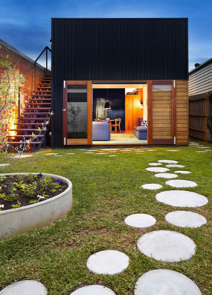 Round concrete pavers / stepping stones in lawn look like bubbles. Modernist, easy to maintain, and fun for bare feet. Bonus large window door to back yard.