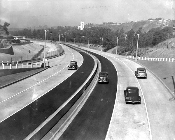 """In this shot we get to see how the first Highland Park segment of the Arroyo Seco Parkway looked like on its opening day, July 20, 1940. I bet the drivers of these four motorcars were thinking, """"Hey, is this is what it'll be like getting around town on these new-fangled freeways, then sign me up. I'll never have to deal with traffic jams again!"""" #FamousLastWords"""