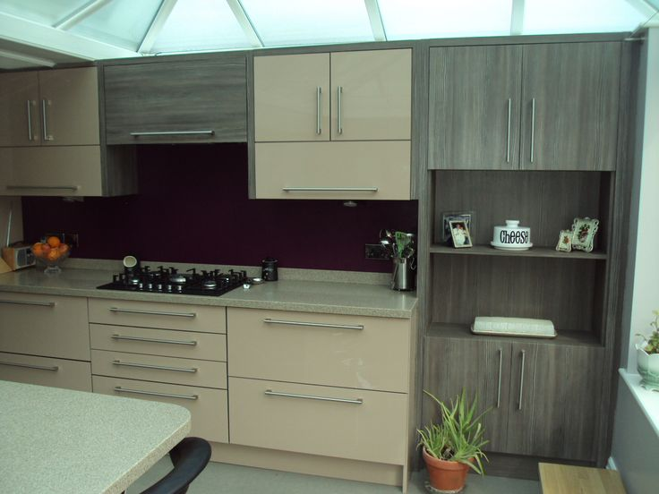 Cappuccino gloss with Avola Brown Grey, siemens appliances and Corian solid surface tops...