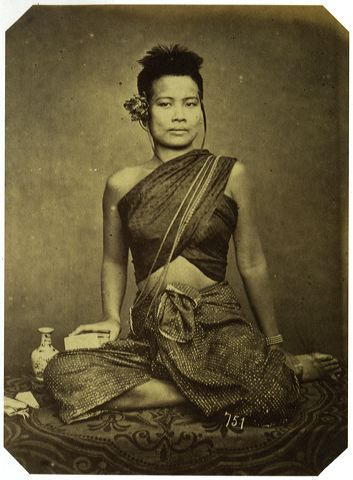 Siamese lady dressed in Sabai across her left shoulder cover with the popular ornamental chain called Chaing, suited with traditional Chang Kben, shooting around late 1800s.