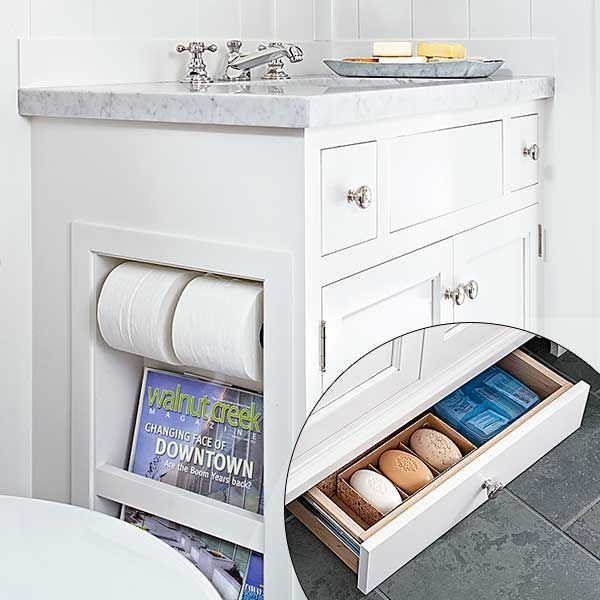 Custom touches by homeowner and DIY cabinetmaker Tim Frazer include a niche for TP and a drawer for bath supplies that slides out of the vanity toekick. He built all the cabinet boxes and ordered doors to fit. [Kids' bath! -UDG]