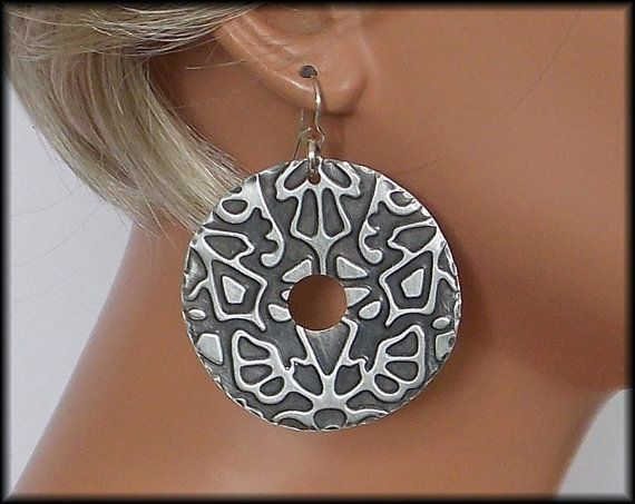 Dramatic! Sure to be noticed! Hand cut from leadfree pewter sheet. Embossed and antiqued. Buffed to highlight raised areas of design. Both sides of earrings have design on them. Circles are about 2 inches in diameter.  Earrings are about 2 1/2 inches in length, inc handforged sterling french wires. NOT HEAVY.