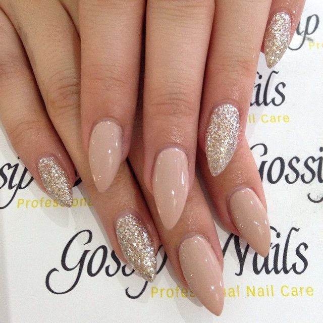 These are elegant stiletto nails. We love the nude color and the little bit of glitter.