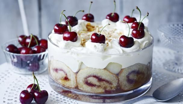 Homemade Swiss roll and soaks up the sherry and adds a special decorative touch to this party-time mega-trifle.
