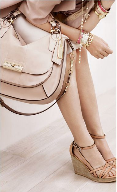 These wedges are great. Maleena, Coach. And dont forget the purse, so basic, yet so sleek!