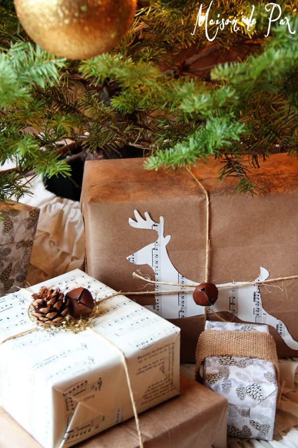 Simple and stunning Christmas gift wrapping ideas: brown bags, sheet music, and silhouettes