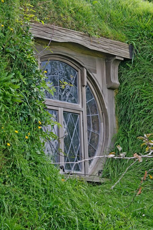 From a distance it looked like several small hills.  Green and rounded, gentle hills.  As they rode closer there was the glint of sunlight on glass.  They saw rounded windows and doors in the hillsides. <3