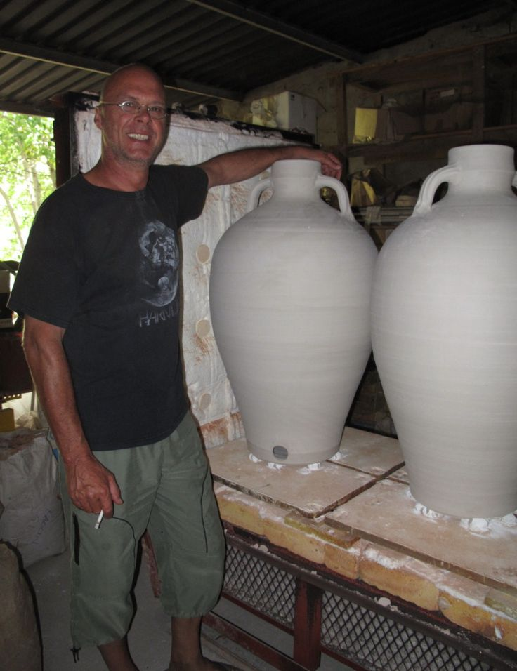With large wine jars prior to firing