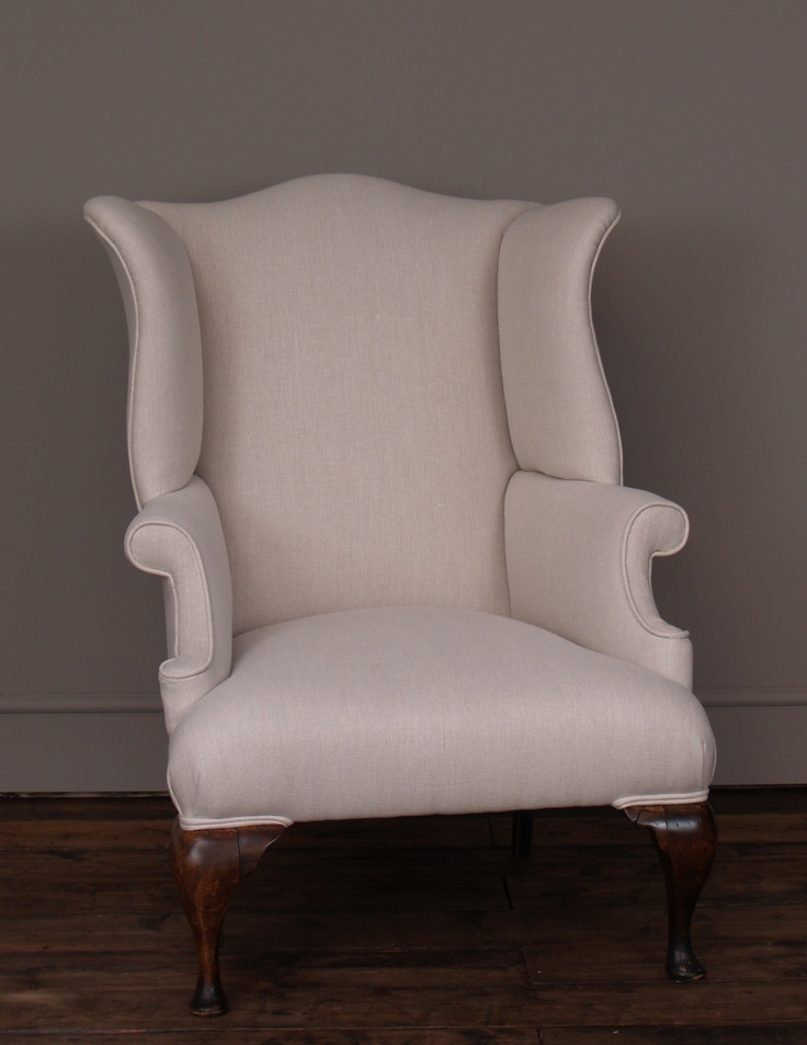 Shapely early C19th English wingback armchair    This curvaceous English chair has wonderful charm and, despite being made around 200 years ago, its timeless style and neutral linen covers make it perfect for 21st century interiors.    The chair has been reupholstered by us in a fabulous quality, natural coloured linen by Sanderson.    Dimensions:  H 104cm W 78cm D 74cm   Seat height 44cm Seat depth 58cm
