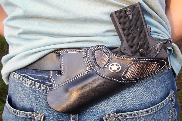 This is a custom leather holster for semi-automatics. This unique holster is made to be carried outside the waist band on the small of your back.