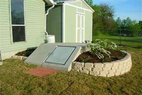 Storm shelter with white landscaping blocks.