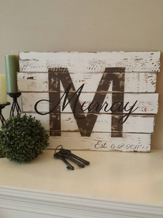Beautiful family initial and last name with establish date. What a wonderful way to honour your family and the day it all began. Perfect addition to your living room, family room, dining area or even your porch or deck. This will make a beautiful gift to celebrate a wedding or anniversary.  This sign measures 17 X 24 with a white chippy shabby chic feel, the initial is painted in chocolate brown and distressed for a warm rustic charm feel and with family name and establish date in black…