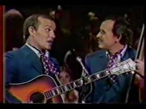 Peter, Paul & Mary, Donovan, and The Smothers Brothers (possible design inspiration for Sir Toby, Sir Andrew, Fabian, and Maria) perform folk music in the round.