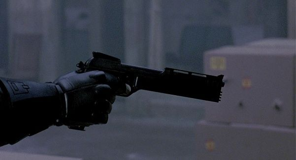 """Beretta 93R (as the """"Auto 9"""")  The main weapon used by RoboCop (Peter Weller) is the """"Auto 9"""". This is a Beretta 93R machine pistol which was heavily modified for the film, featuring a longer barrel with an enormous compensator/flash hider shaped like a casket, plastic grips, and a taller rear sight to match the raised front sight. Typically, RoboCop fires this weapon in 3-round burst mode. The fictional stats of the weapon claim it has an implausibly huge 50-round magazine."""