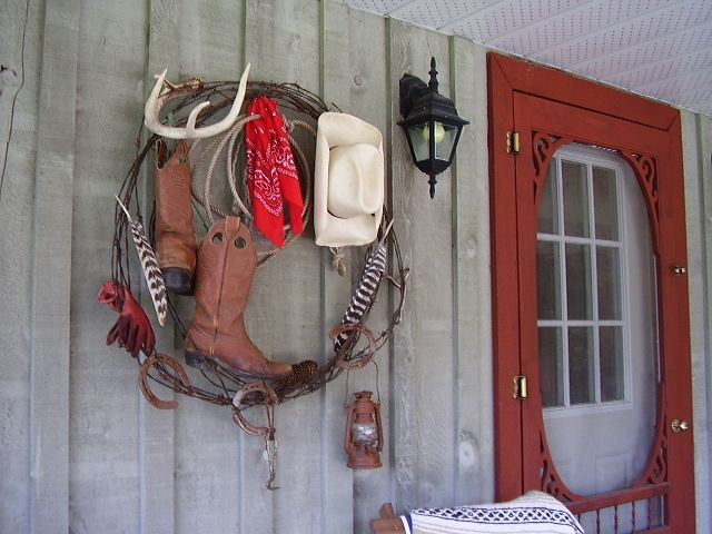 Cowboy wreath using barbed wire, boots, and hat