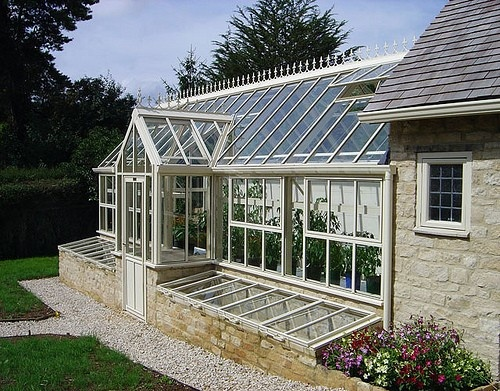 Gorgeous greenhouse with cold frames, maybe attached garden shed.