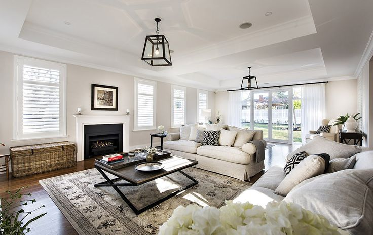 Hamptons style living room with slip cover sofas - Oswald Homes