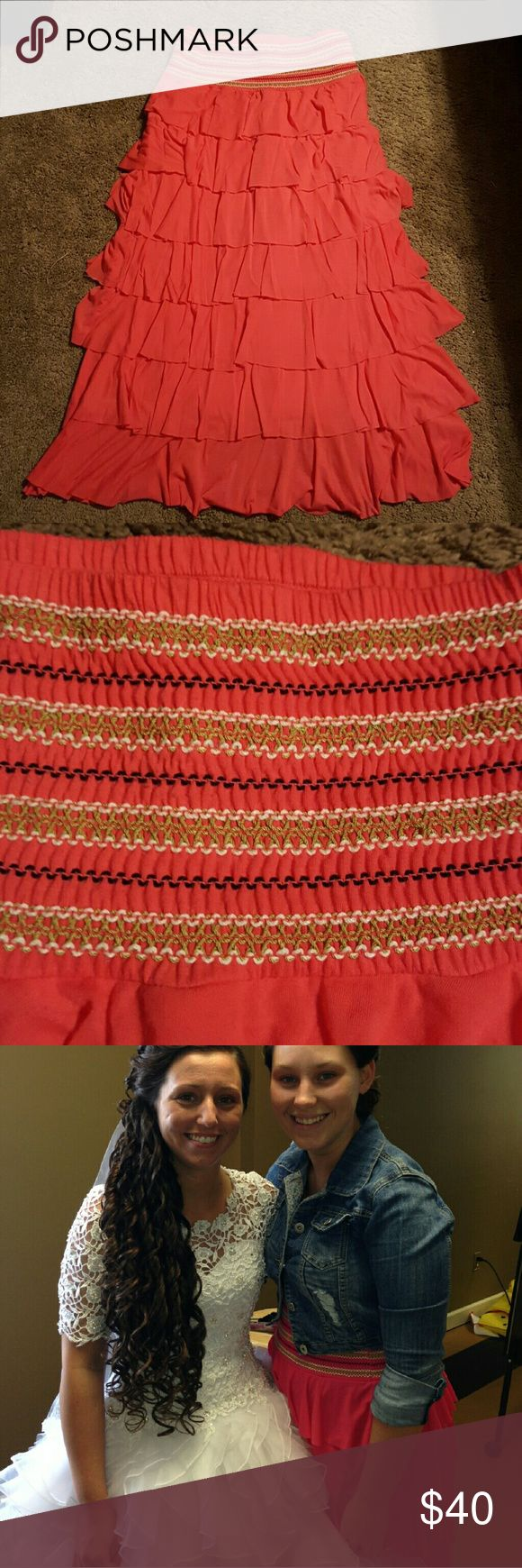 Beautiful long bright pink ruffled skirt Beautiful long bright pink ruffled skirt with elastic band at top. Band has black, white and green designs as pictured above. Worn only a few times. Is in excellent condition. Willing to negotiate price. Cristina Skirts Maxi