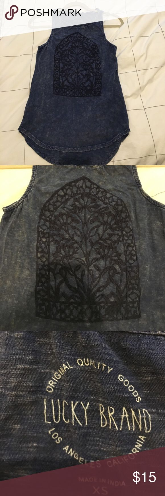XS LUCKY BRAND DENIM WASHED TANK Never worn purchased at the lucky store, super cute denim washed with center floral embroidery tank. Perfect condition, PAIR WITH: white jeans/cut offs and wedges or espadrilles! Lucky Brand Tops Tank Tops