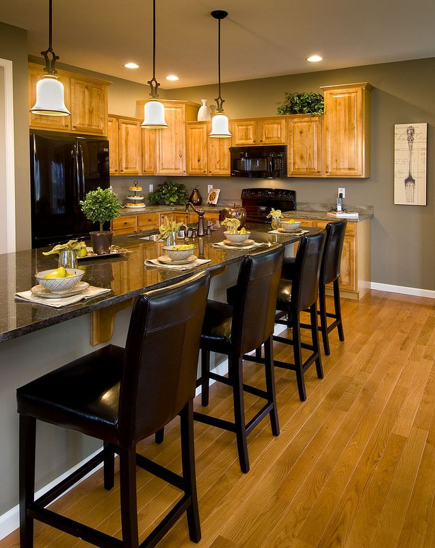 I must find out what this paint color is!!!!!!  Model Kitchen with Oak Cabinets - like the paint color - looking for color schemes for a possible new apartment with oak cabinets