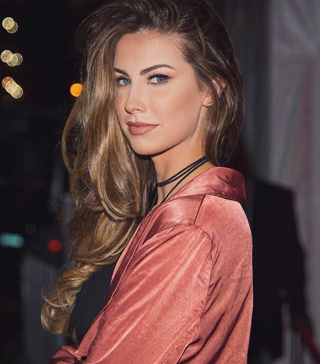 The rosy makeup. The Cindy Crawford hair. Gorgeous Katherine Webb-McCarron!