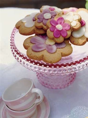 Celebrate spring by transforming basic butter cookies into colorful blooms. Make varying sizes and use different colors of icing for a cheerful display. Recipe: Butter Cookies with Royal Icing   - CountryLiving.com