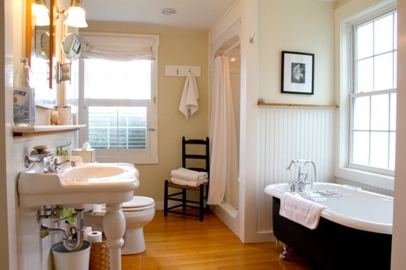 farmhouse bathroom  Like the bead board, tub, sink...  Oh heck I think I like everything about this space.  Love the wall color choices.