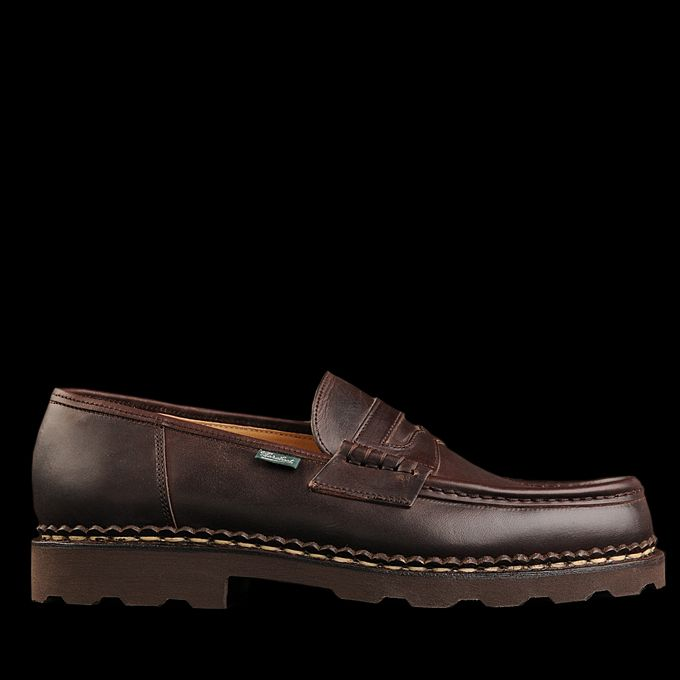 This shoe has a classic loafer upper with a rugged crepe sole and features  Paraboot's s.