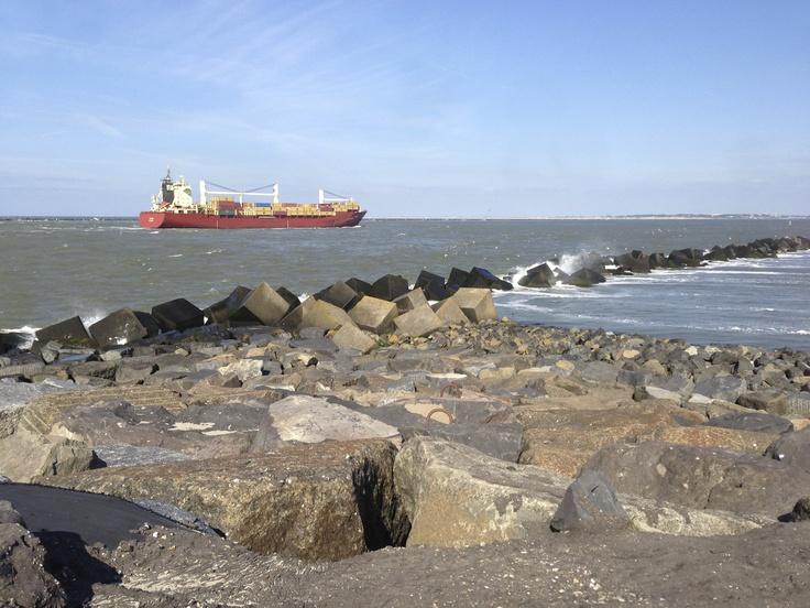 Cargo ship sail near the harbor of the 2nd Maasvlakte