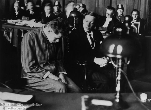 Before the Reich Court in Leipzig: The Defendant Marinus van der Lubbe with his Interpreter (September 24, 1933). He was charged with setting fire to The Reichstag in Berlin.