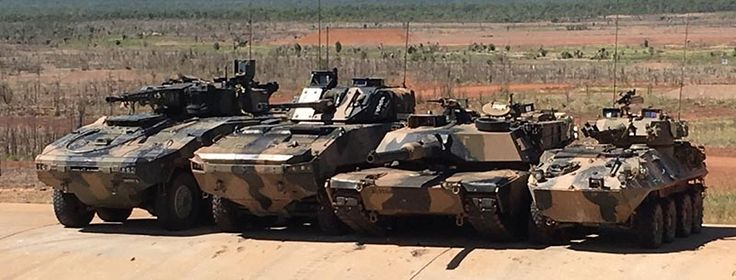 From left to right above – Rheinmetall Boxer CRV, BAE Systems Australia/Patria AMV-35, an Australian Army Abrams main battle tank and an ASLAV at Mount Bundey, Northern Territory. Photographer unknown.