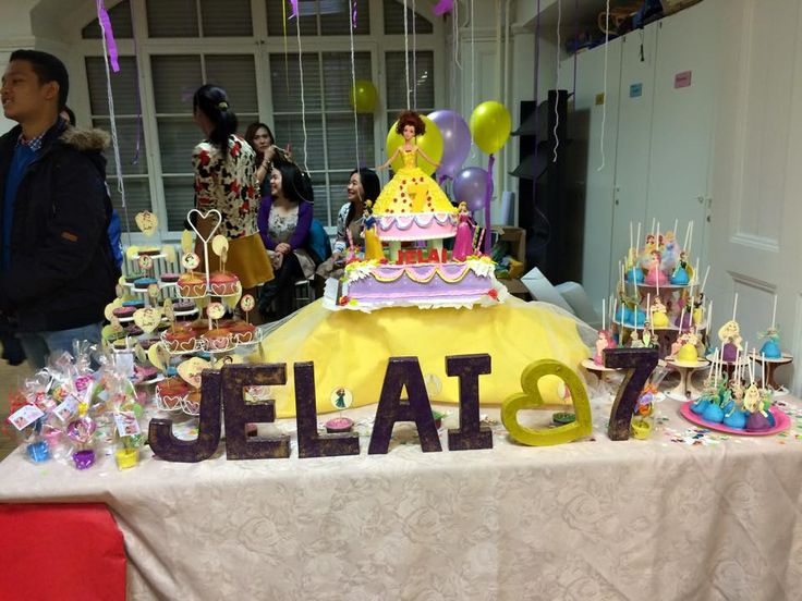 Cake Table. Carton painted letter name, Barbie belle doll with the disney princess cake toppers, cake pops, cupcakes & souvenirs.