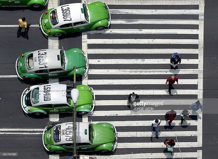 'Beetle' Volkswagen taxis circulate 28 July 2003 along an avenue in Mexico City. The last car of this model will leave 31 July the Volkswagen factory in Puebla, 110 km west of the Mexican capital. The car number 3000 of this particular series of the model will not be put on sale, but will remain on exhibition in the German city of Wolfburg instead, near the main Volkswagen plant of Autostaadt, where the 'beetle' was produced for the first time last century, in the 30's. / AFP / JORGE