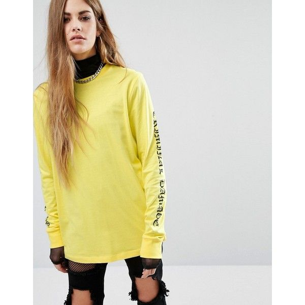 Criminal Damage Oversized Long Sleeve T-Shirt With Gothic Arm Text (€49) ❤ liked on Polyvore featuring tops, t-shirts, yellow, long sleeve t shirts, long sleeve tops, tall tees, oversized long sleeve t shirt and cotton t shirts