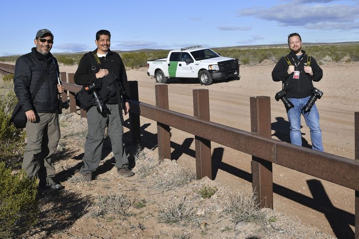 (L-R) AFP's photographers Guillermo Arias, Yuri Cortez and Jim Watson are pictured at metal fence between US and Mexico  in Puerto Palomas, Chihuahua state on February 19, 2017.