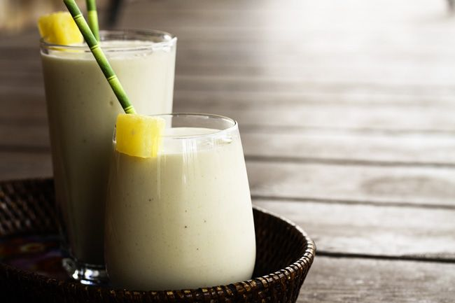 These super creamy, indulgent tasting, family friendly pineapple and coconut Piña Colada Smoothies will transport you to the tropics in a matter of minutes. Using only 3 easy-to-find and healthy ingredients just boosts the appeal of this naturally vegan, dairy-free treat!  If you've got a hankering to make this a true piña colada, you can stir in a shot of rum before serving.