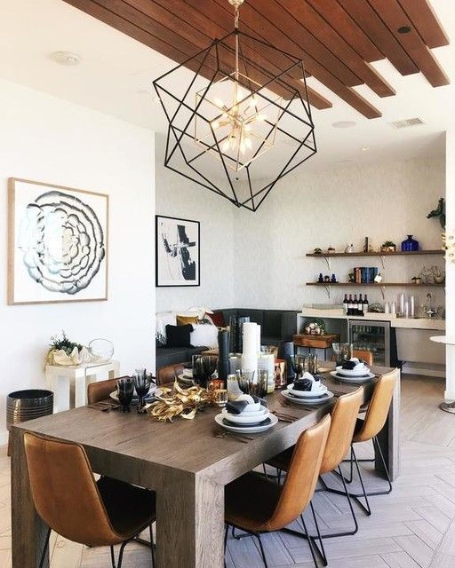 Warm neutral dining room. Woods and leathers. Wood plank ceiling detail. Oversized geo chandelier. Simple art.