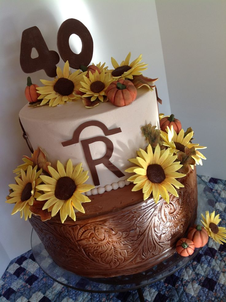 Tooled Leather and Sunflower birthday cake for a son - Choc. Fudge torted and filled with Peanut Butter filling, Covered in buttercream with fondant tooled leather. Sunflowers, leaves, brand and numbers of gumpaste.