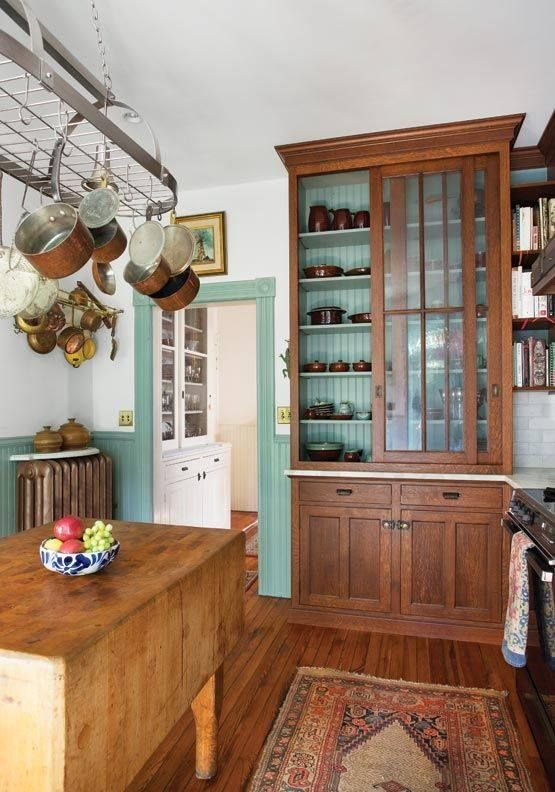 I like the vintage look here - the cabinet, the bead board, the trim around the door - the colors are lovely, however I wish to stick to white and natural wood